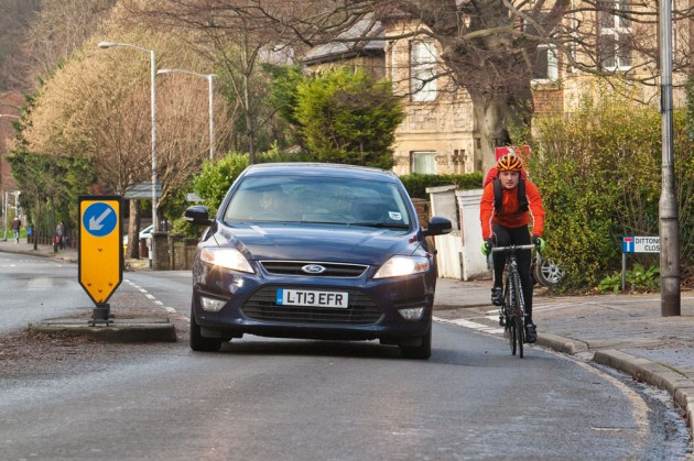 Car_Cyclist_Traffic_island_road_rage-630x419