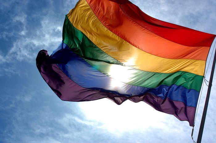 1200px-rainbow_flag_and_blue_skies