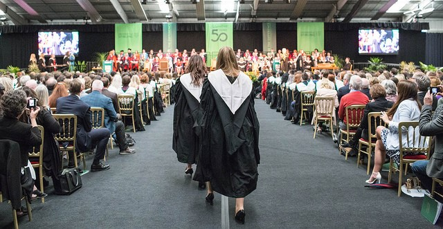 Girls walk to graduation