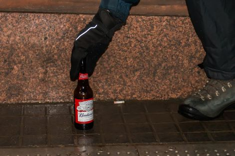 The pastors remove empty bottles from the street Credit: Stirling Street Pastors